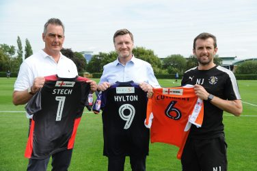 Certsure's communications manager Paul Collins (middle) with Luton Town FC manager Nathan Jones (right) and Luton Town FC Commercial manager Dave Hoskins.